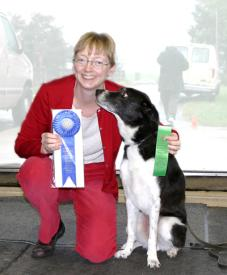 "Fuligin Ged Tycho, CDX, AX, AXJ, ""Tycho"", earns First Place in Open B Obedience and High In Trial at the 2004 CDCA National Specialty, making owner and handler Jennie Larkin very happy."
