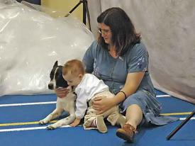 CH Mazel Tov Hana Her My Heart with Cris Garland and baby Kaelin, resting during the 2005 National Specialty.